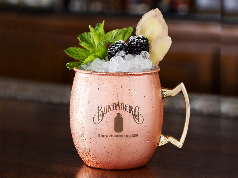 Kentucky Mule Cocktail made with Bundaberg Ginger Beer, served in copper mug with ice and garnishes